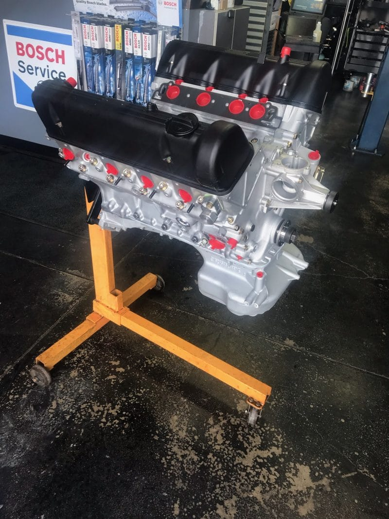 deutschland autowerks rebuilt mercedes-benz motor on stand ready to be installed