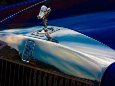 deep blue exotic rolls royce phantom car hood with hood ornament and logo in brilliant chrome